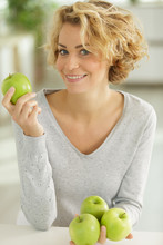 Happy Woman With Green Apple I...