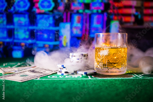 Photo  gambling, fortune, game and entertainment concept - close up of casino chips and