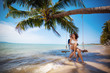 canvas print picture - Couple on swing on tropical beach