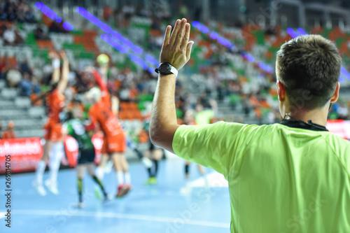Handball referee gives signal playing for time during handball match Billede på lærred