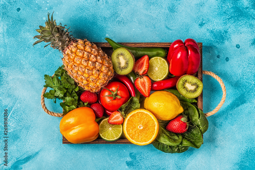 Fototapeta Fruits and vegetables rich in vitamin C in box.
