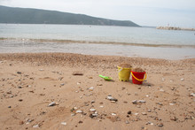 Kid's Toy Bucket Lost Among Cl...