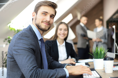 Fototapeta Businessman with colleagues in the background in office. obraz