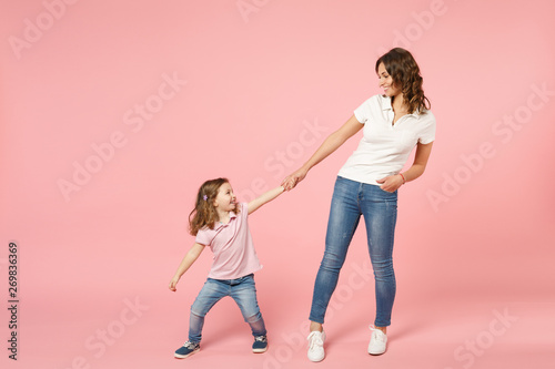 Woman in light clothes have fun with cute child baby girl Canvas Print