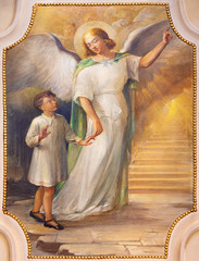 COMO, ITALY - MAY 9, 2015: The fresco of guaridian angel in church Chiesa di San Andrea Apostolo (Brunate) of by T. Conconi (1936).