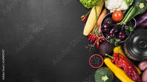 fresh vegetables and on black table