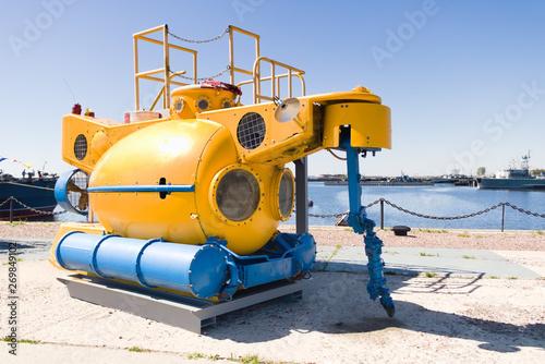 Fotografia, Obraz Small yellow rescue bathyscaphe with illuminators and mechanical manipulators