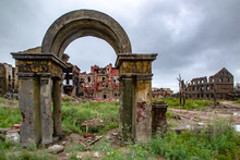 Destroyed Town. The Remains Of The Ruined Arch. Shambles Of Houses. Apocalypse. Dead City. Ghost Town.