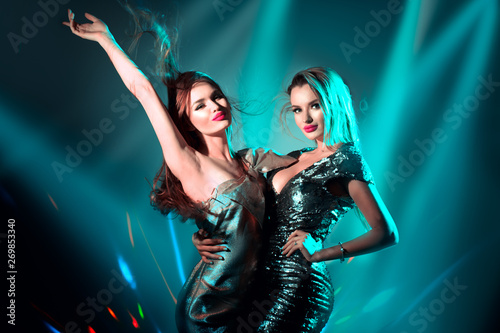 Hot model girls dancing in UV neon lights Wallpaper Mural