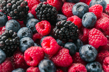 Fresh Summer Berries mix Background with Strawberry, Raspberry, Red currant, Blueberry and Blackberry.