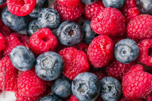 Canvas Prints Fruits Fresh Summer Berries mix Background with Strawberry, Raspberry, Red currant, Blueberry and Blackberry.