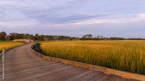Valokuvatapetti Sunrise and the boardwalk over the Palencia salt marsh in St