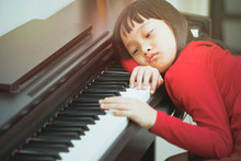 The Girl Bored To Leaning Piano