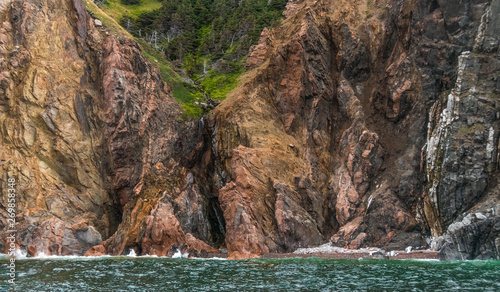 Photo View of Cape Breton Island from a boat on the water.