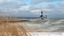 St. Joseph Michigan North Pier Lighthouse Setting At The Mouth Of The St. Joseph River As It Empties Into Mighty Lake Michigan Protecting Boats From The Shallow Waters And Providing A Light Beacon