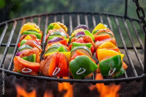 Poster Echelle de hauteur Homemade skewers on grill with meat and vegetables in summer