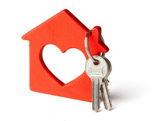 Wooden Red House And Keys Isolated On White Background.