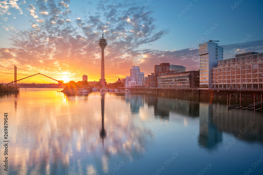 Fototapety, obrazy: Dusseldorf, Germany. Cityscape image of Düsseldorf, Germany with the Media Harbour and reflection of the city in the Rhine river, during sunrise.
