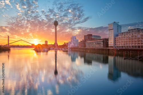 Recess Fitting Blue jeans Dusseldorf, Germany. Cityscape image of Düsseldorf, Germany with the Media Harbour and reflection of the city in the Rhine river, during sunrise.