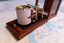 Vintage Marine Barograph With Opened Cover Standing On A Navigational Chart