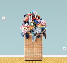Beige Straw Basket Full Of Dirty Laundry