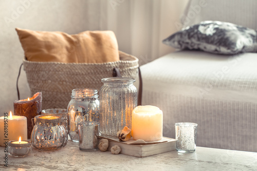 Fototapeta home still life with candles and vase in the living room obraz