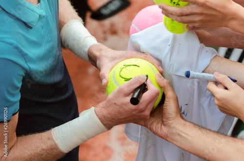 Tennis player signs autograph after win Canvas Print