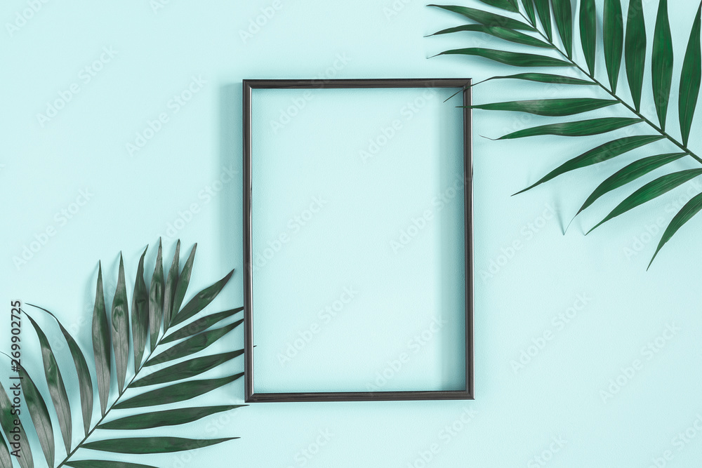 Fototapety, obrazy: Summer composition. Tropical palm leaves, black photo frame on pastel blue background. Summer, nature concept. Flat lay, top view, copy space