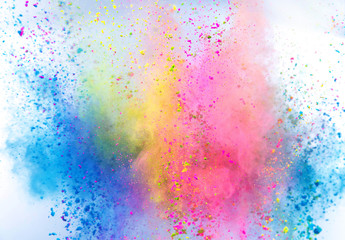 Colored powder explosion on white background. Freeze motion.