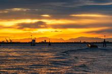 Beautiful Sunset At Adriatic Sea Near Port Of Venice.