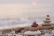 stack of zen stones on pebble beach