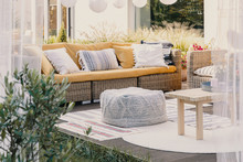 Stylish Outdoor Relax Area With Garden Furniture And Comfortable Pouf, Real Photo