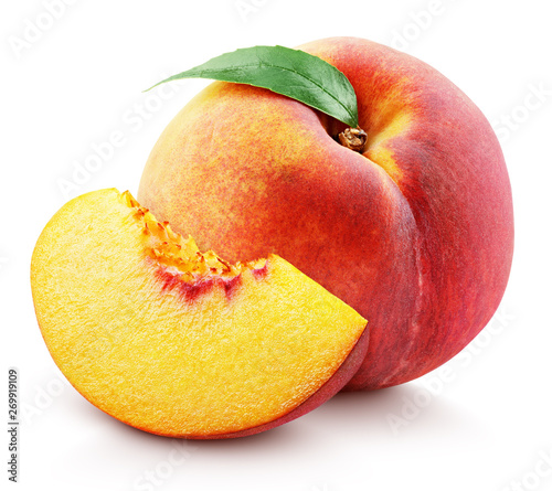 Leinwand Poster Ripe whole peach fruit with green leaf and slice isolated on white background with clipping path