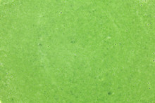 Closeup Of Spinach Soup, Detail Bubbles On Green Liquid. Healthy Leaves Vegetables Food Concept