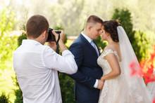 Wedding Photographer Takes Pic...