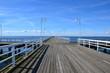 Wooden pier in Jurata town at sunny, summer day. Coast of Baltic Sea at Hel peninsula, Poland
