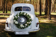 "Wedding Car With A Decoration In The Form Of A Wreath And The Word ""Wedding"""