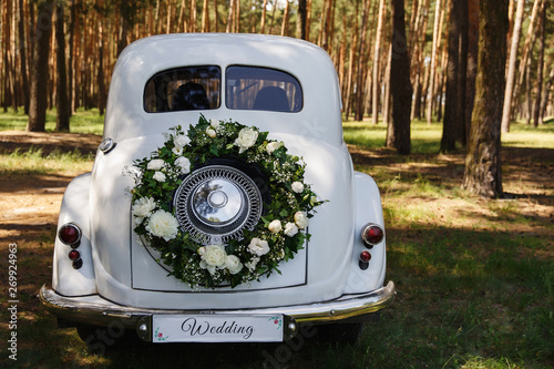 Fotografie, Obraz  Wedding car with a decoration in the form of a wreath and the word Wedding