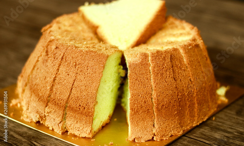 Fotografie, Obraz  Pandan chiffon cake on wood background.