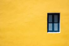 Blue Window On Yellow Wall