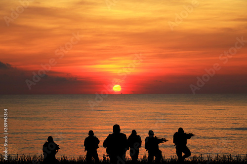 Navy seal silhouettes  on sunrise Canvas Print