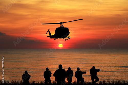 Photo  Navy seal silhouettes  on sunrise