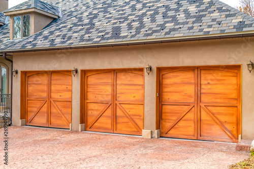 Luxurious exterior of a house with stylish brown wooden garage doors Canvas Print