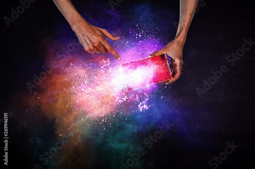 Pinturas sobre lienzo  Man s hands holding a small magic paper box, mixed media