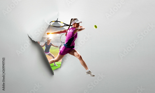 Photo  Paper torn hole effect with female tennis player. Mixed media