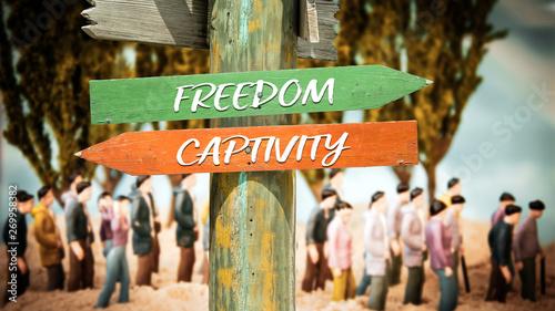 Canvas Print Street Sign to Freedom versus Captivity