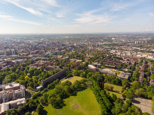 Foto op Aluminium Aerial footage of the Leeds town of Headingley, the footage shows Terrence houses and homes and the town centre in the background with roads and traffic, taken on a beautiful sunny day.