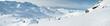 Leinwanddruck Bild - Panoramic view across snow covered alpine mountain range
