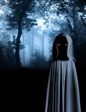 Spooky Monster In Hooded Cloak In Misty Forest
