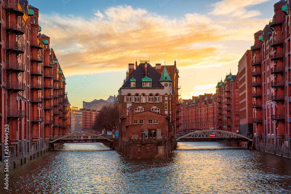 Fototapety, obrazy: The Warehouse district Speicherstadt during sunset in Hamburg, Germany. Old warehouses in Hafencity quarter in Hamburg.
